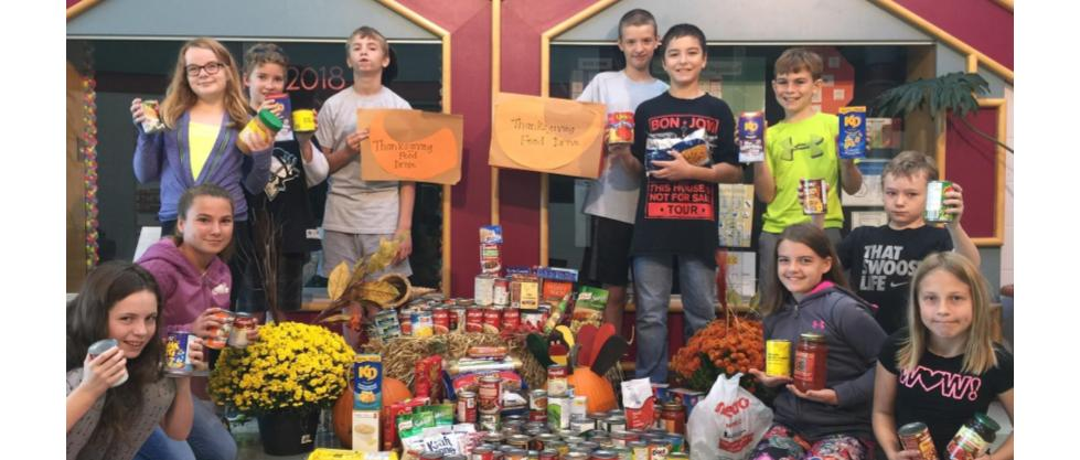 Student collecting donations for food drive 2017