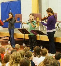 Students playing their fiddles